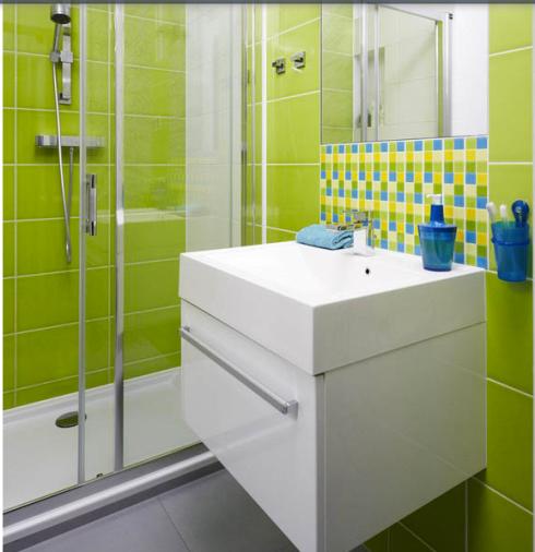 O tom de verde também foi utilizado no banheiro!
